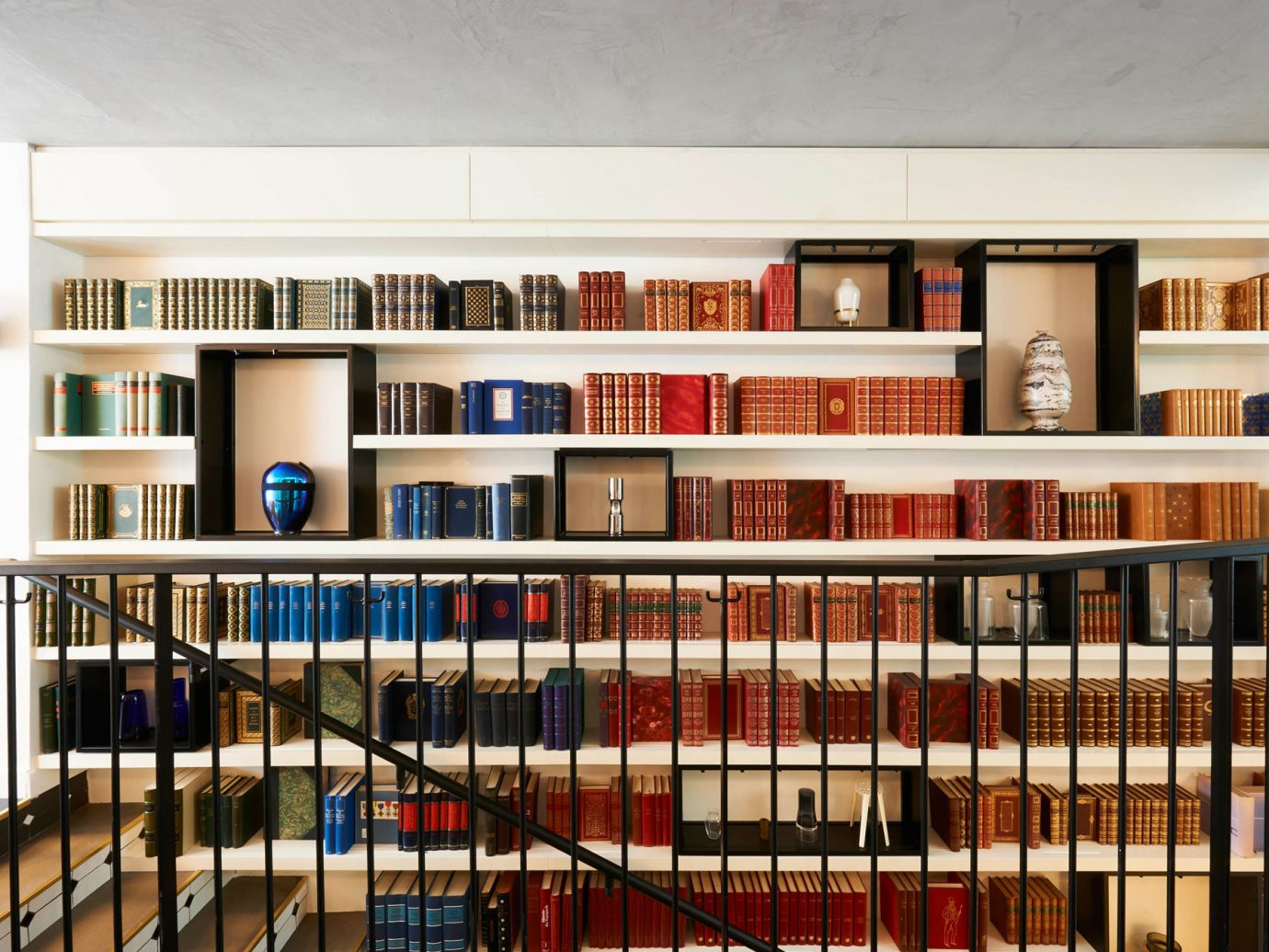 Hotels indoor library shelf ceiling public library building shelving furniture bookcase interior design bookshelf
