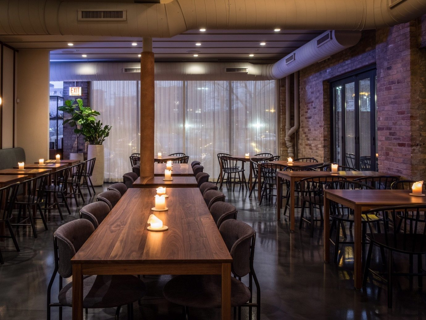 Food + Drink table floor indoor ceiling room chair Dining wooden restaurant function hall Bar estate interior design meal furniture ballroom wood area several dining room
