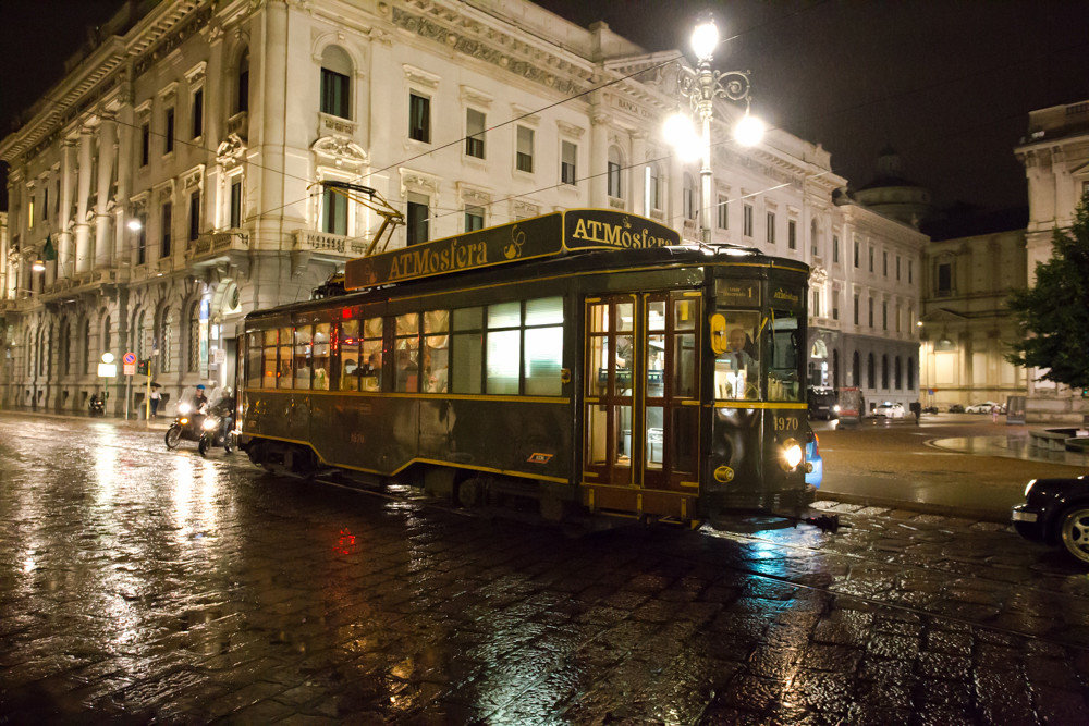 Buildings cable car City city lights city streets lights night lights streets train tram transportation Trip Ideas trolley building outdoor metropolitan area night transport vehicle urban area street public transport evening cityscape waterway reflection way rain rainy traveling