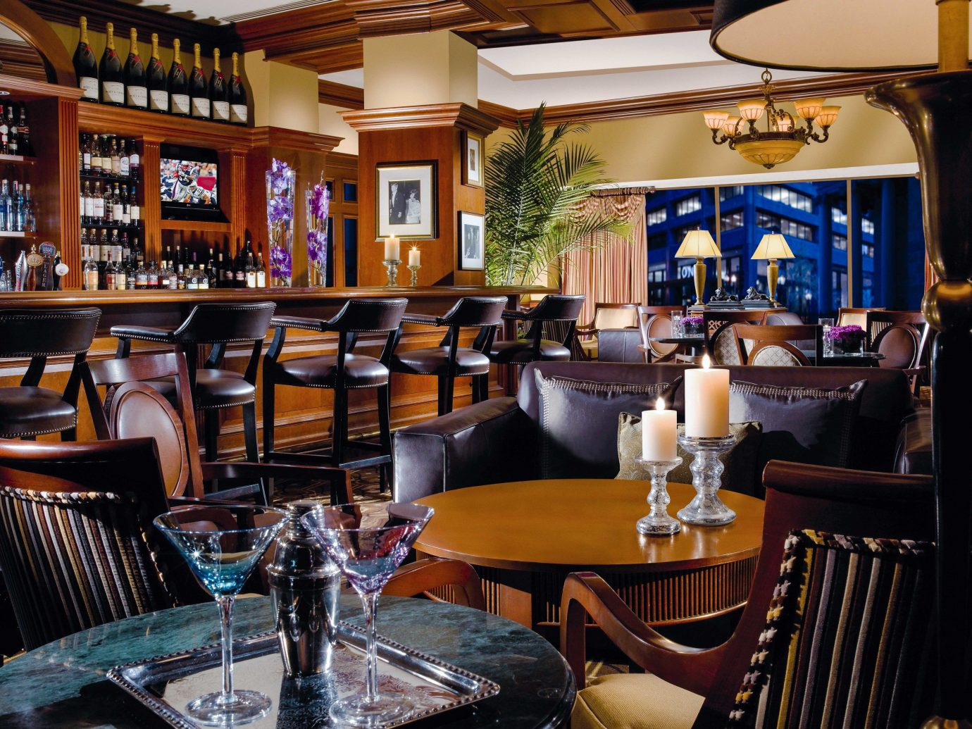 Hotels table indoor chair restaurant Dining room Bar interior design café coffeehouse furniture area set dining table