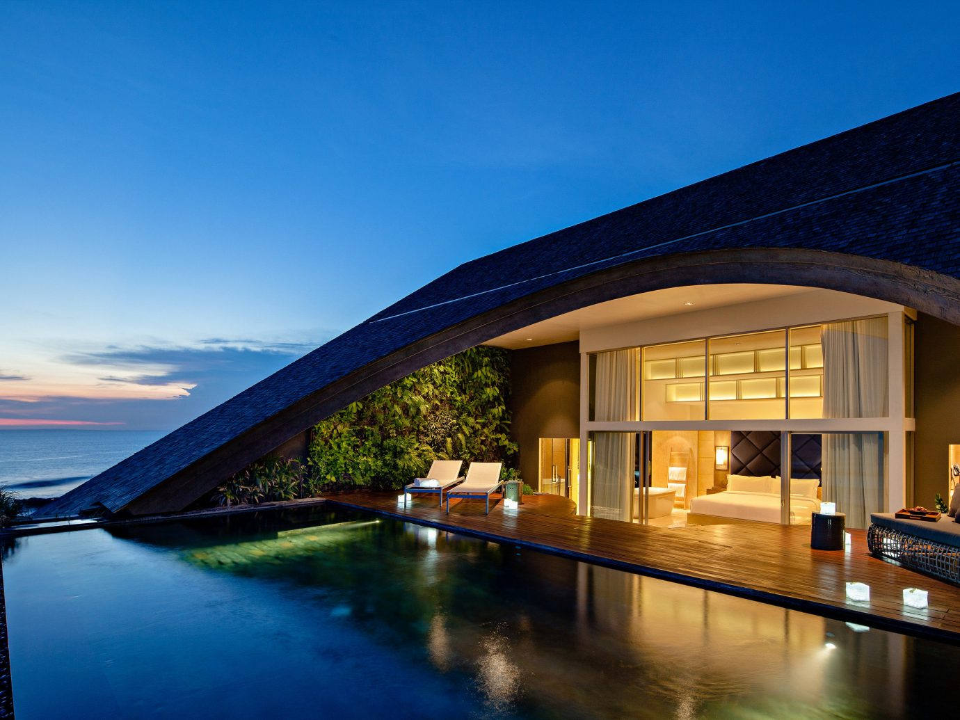 Spring Trips Trip Ideas reflection sky property Architecture water house real estate estate home lighting evening building Villa Resort roof facade hotel Sea