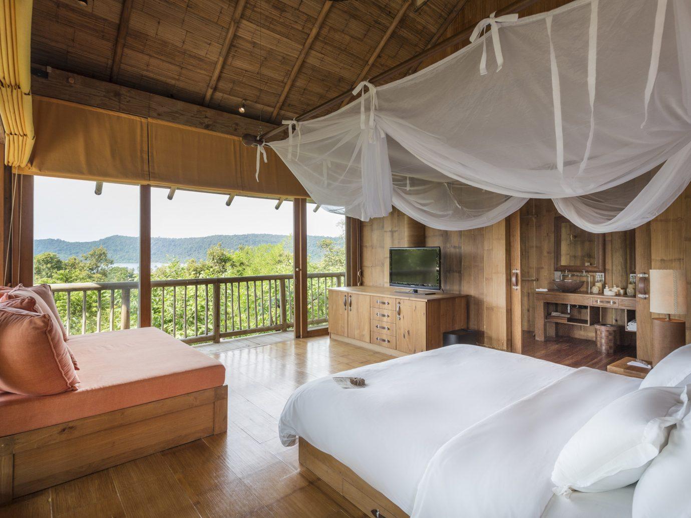 Health + Wellness Hotels Yoga Retreats indoor floor room property Resort estate interior design Bedroom cottage bed Villa Suite real estate furniture several