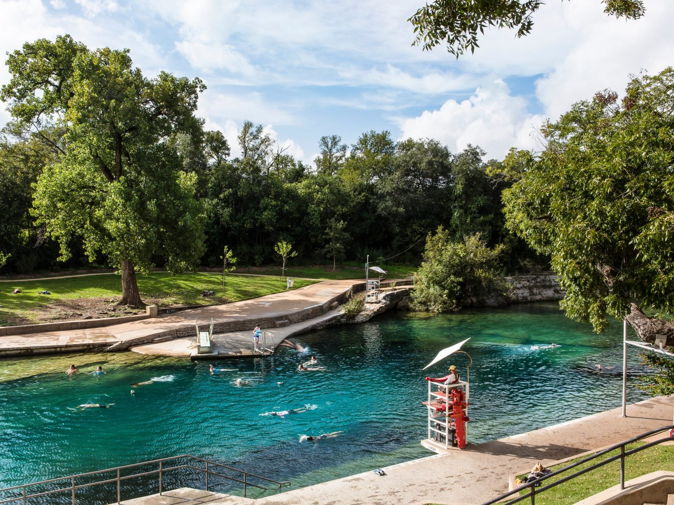 Arts + Culture Austin Nashville Trip Ideas Weekend Getaways tree outdoor water Boat swimming pool estate River Pool waterway Lake pond docked backyard shore swimming surrounded day