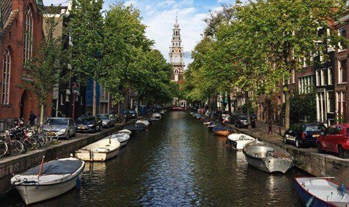 Jetsetter Guides tree outdoor water Boat Canal waterway geographical feature landform body of water River Town docked channel lined several