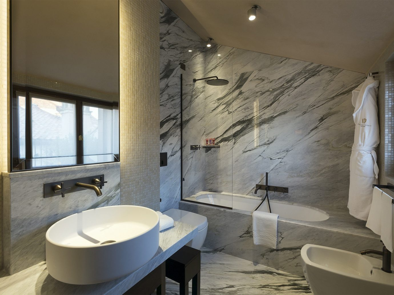 Hotels Italy Luxury Travel Venice indoor bathroom wall window ceiling room property sink Architecture interior design estate floor real estate home tile flooring daylighting interior designer tub Bath bathtub stone
