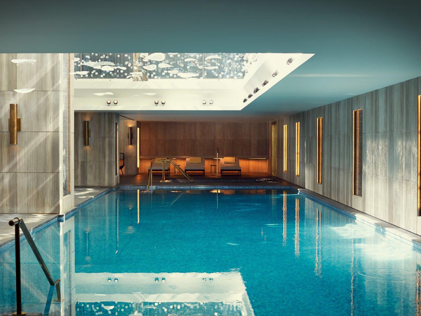 Boutique Hotels Hip Hotels Lounge Luxury Luxury Travel Modern Pool floor indoor swimming pool property room estate leisure centre interior design home blue real estate condominium Design mansion Resort