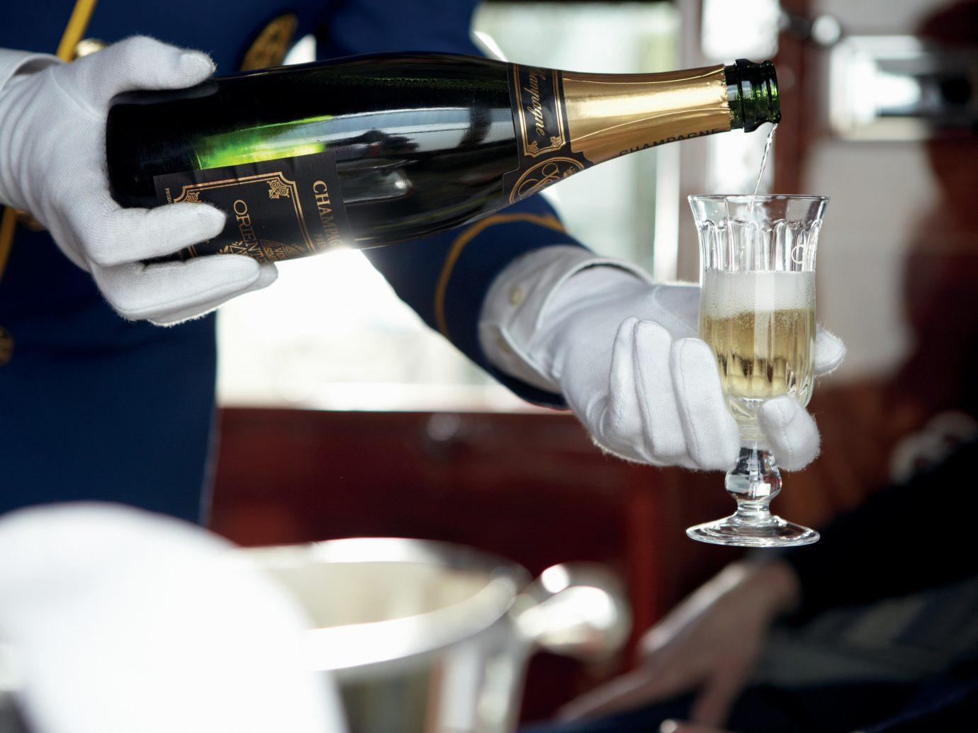 Luxury Travel Trip Ideas indoor alcohol Drink vehicle drum wine glass appliance