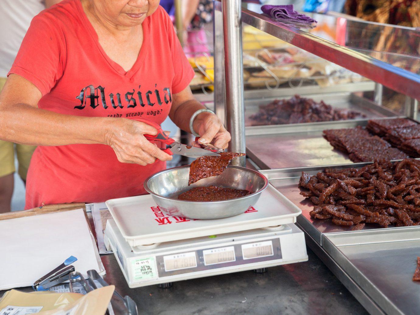 Food + Drink person indoor food vendor meal bakery dessert sense baking preparing baked