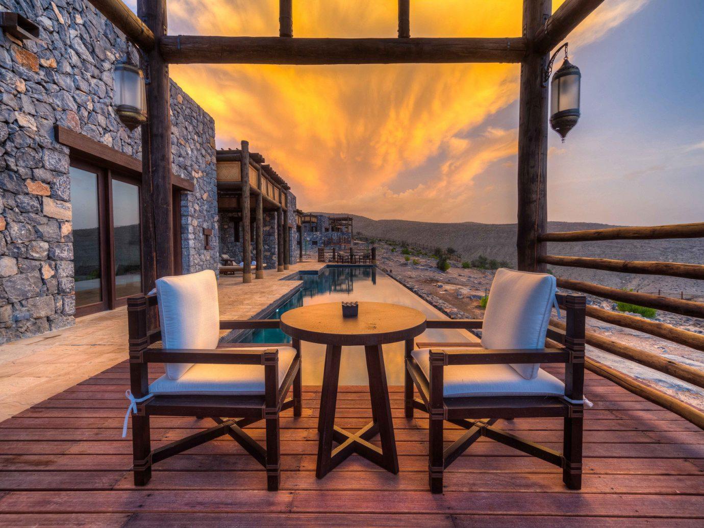 Travel Tips floor room estate Resort wood restaurant interior design evening cottage