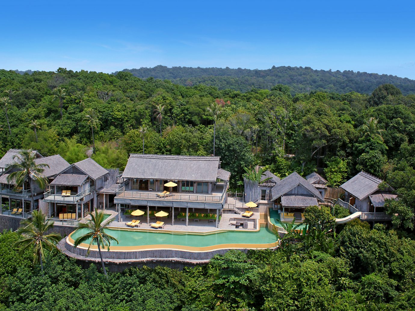 Health + Wellness Hotels Yoga Retreats tree outdoor property estate house Resort mountain mansion residential area Villa home Village cottage lush surrounded