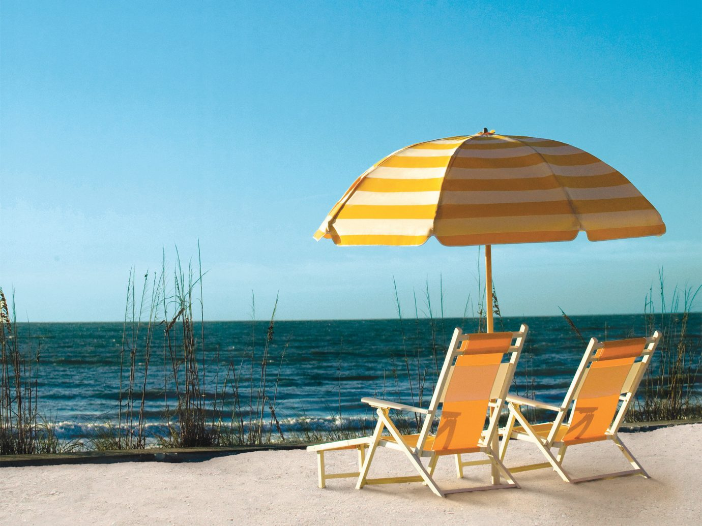 Hotels isolation lounge chairs private relaxation remote sand Secret Getaways Trip Ideas sky outdoor chair umbrella ground leisure Beach Sea vacation Ocean seat shore set day