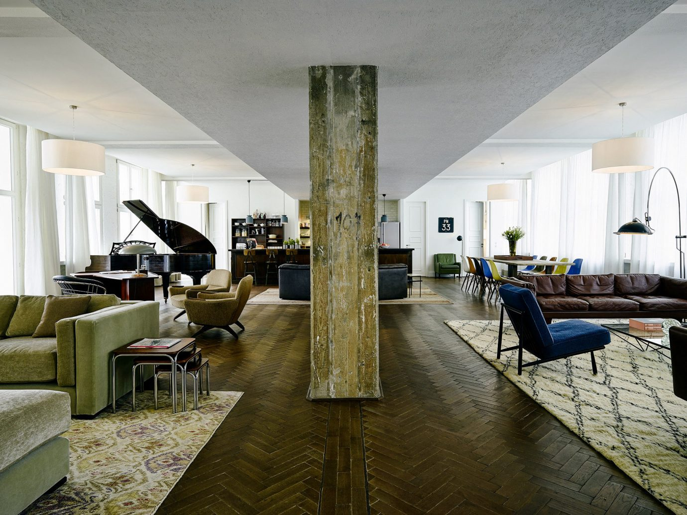 Berlin Boutique Hotels Germany Hotels Luxury Travel indoor floor ceiling room wall interior design Living living room Lobby furniture apartment real estate flooring penthouse apartment house interior designer Suite area several