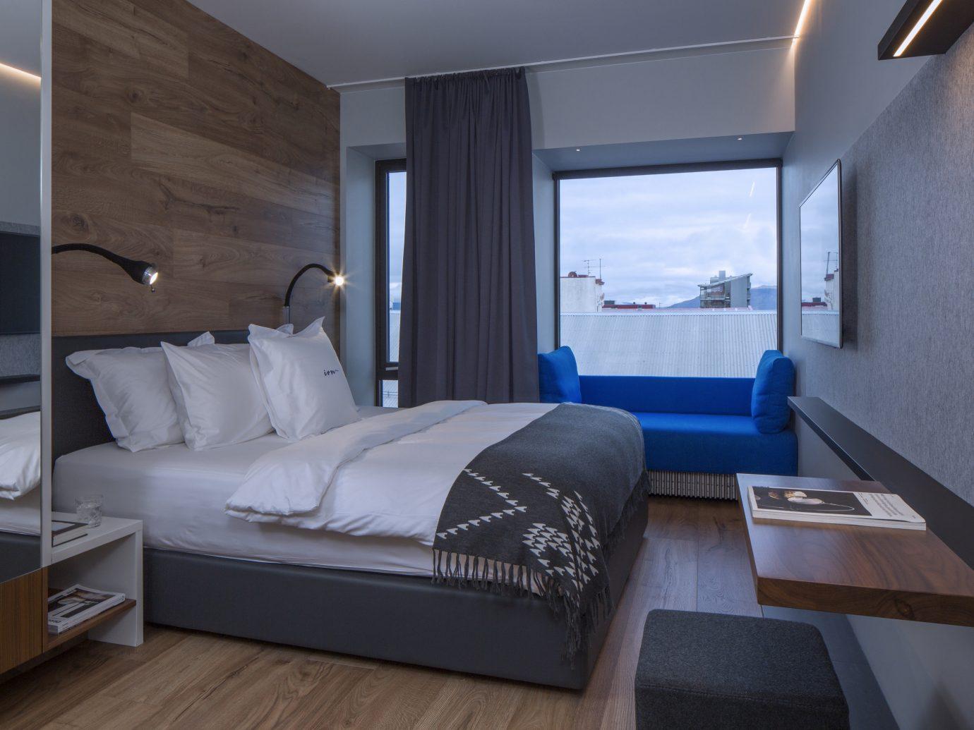 Boutique Hotels Hotels Iceland Outdoors + Adventure Reykjavík Road Trips indoor floor wall window room bed Suite interior design hotel Bedroom ceiling interior designer furniture