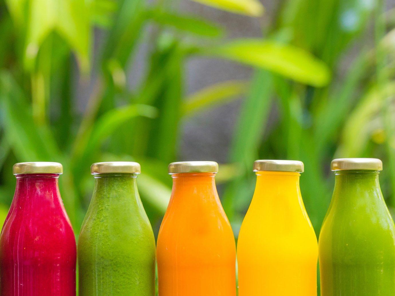 Hotels bottle green juice Drink food produce glass bottle drinkware beer bottle beverage colored