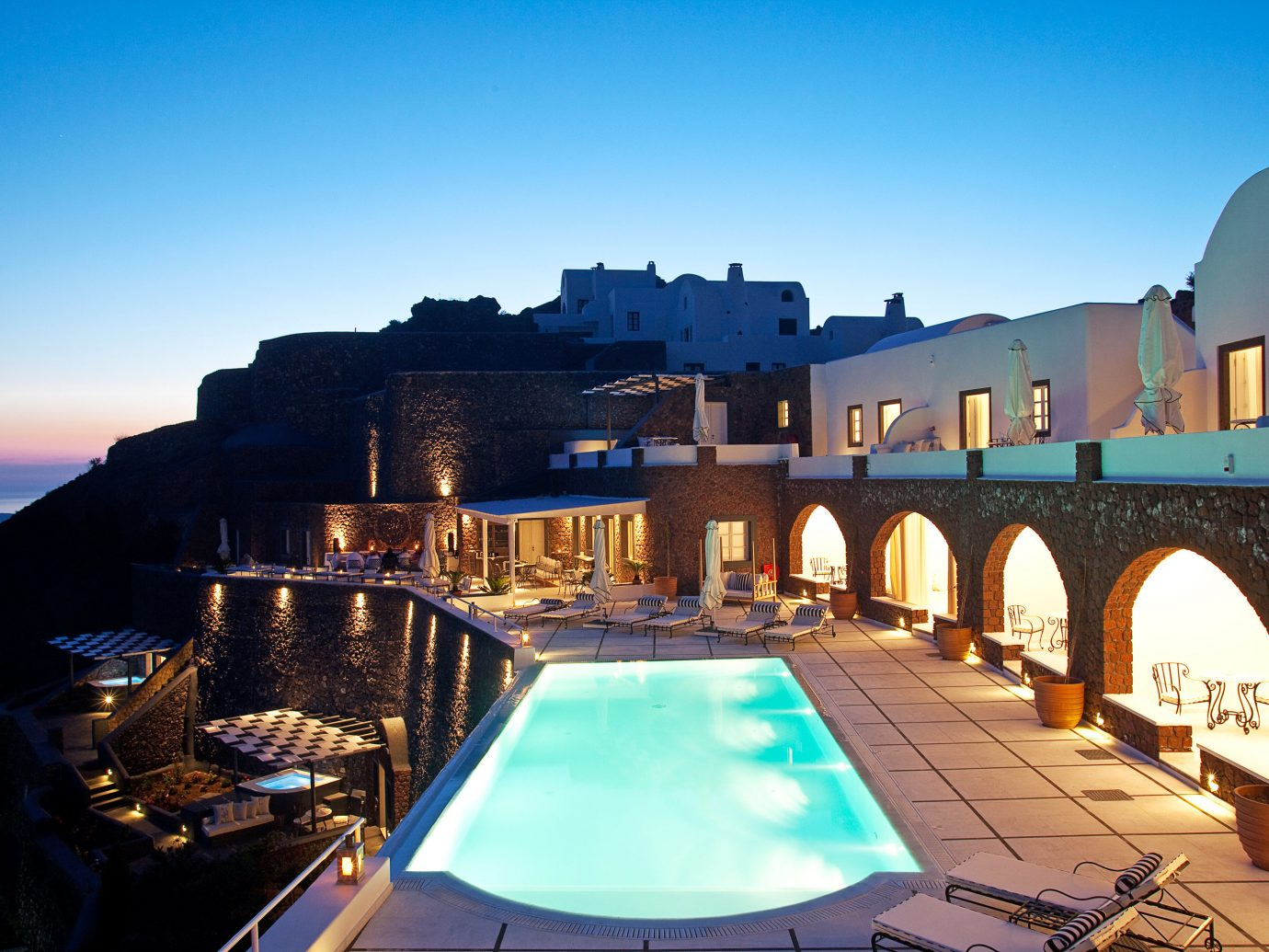 Beach Beachfront Greece Hotels Lounge Luxury Modern Ocean Pool Santorini sky outdoor vacation evening estate dusk Sea swimming pool cityscape Resort