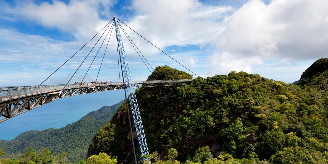 Trip Ideas sky outdoor bridge landmark tree mountain cloud hill nonbuilding structure suspension bridge