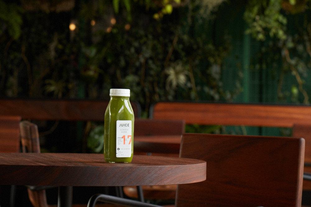 artisanal coffee shop Drink gourmet Health + Wellness juice Travel Tips tree green wooden furniture table lighting wood restaurant
