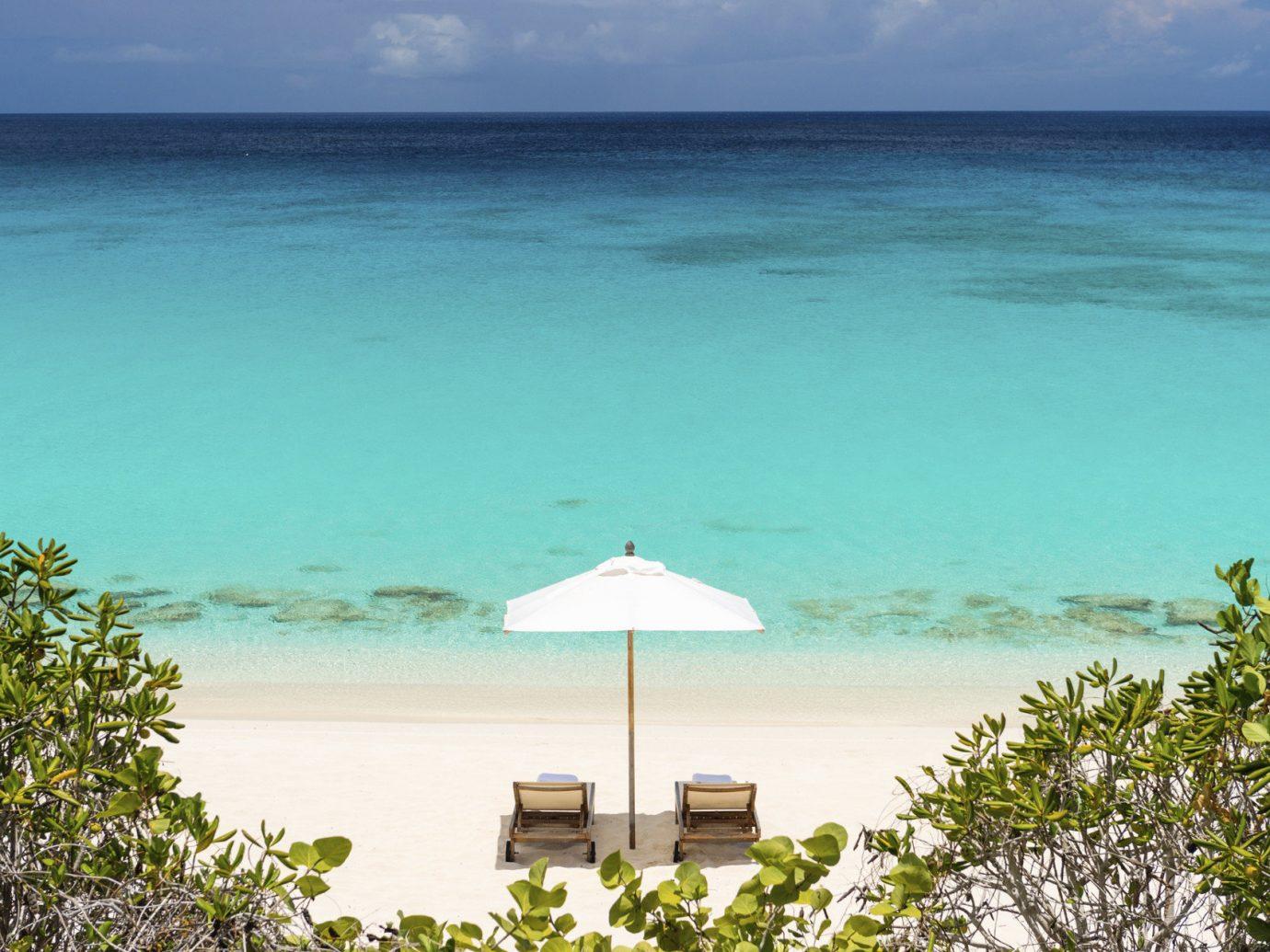 Hotels water sky outdoor Beach shore Sea Ocean body of water horizon caribbean vacation Coast Nature bay tropics sunlight cape Island Lagoon swimming sandy day