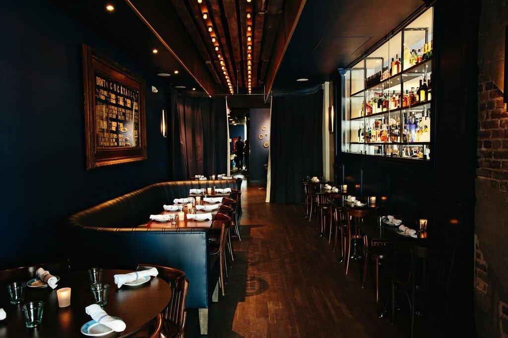 ambient lighting artistic artsy Bar bar seating chic cozy dark Dining Food + Drink Hip interior moody night restaurant stylish tables trendy urban indoor floor interior design café dining room