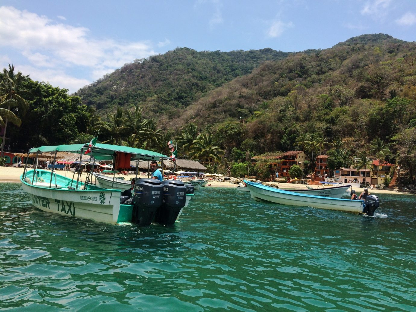 Travel Tips outdoor water sky Boat landform vehicle Sea mountain boating green vacation tourism bay River Island Coast Lagoon watercraft
