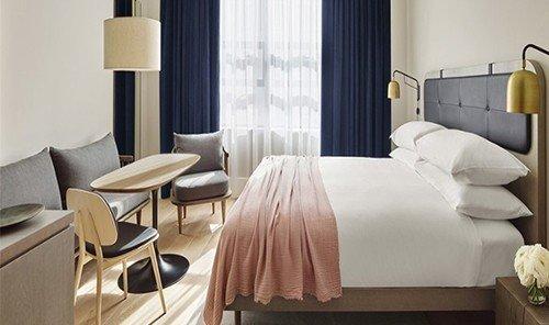 Hotels indoor wall floor room window property chair hotel Suite interior design living room apartment furniture Bedroom area