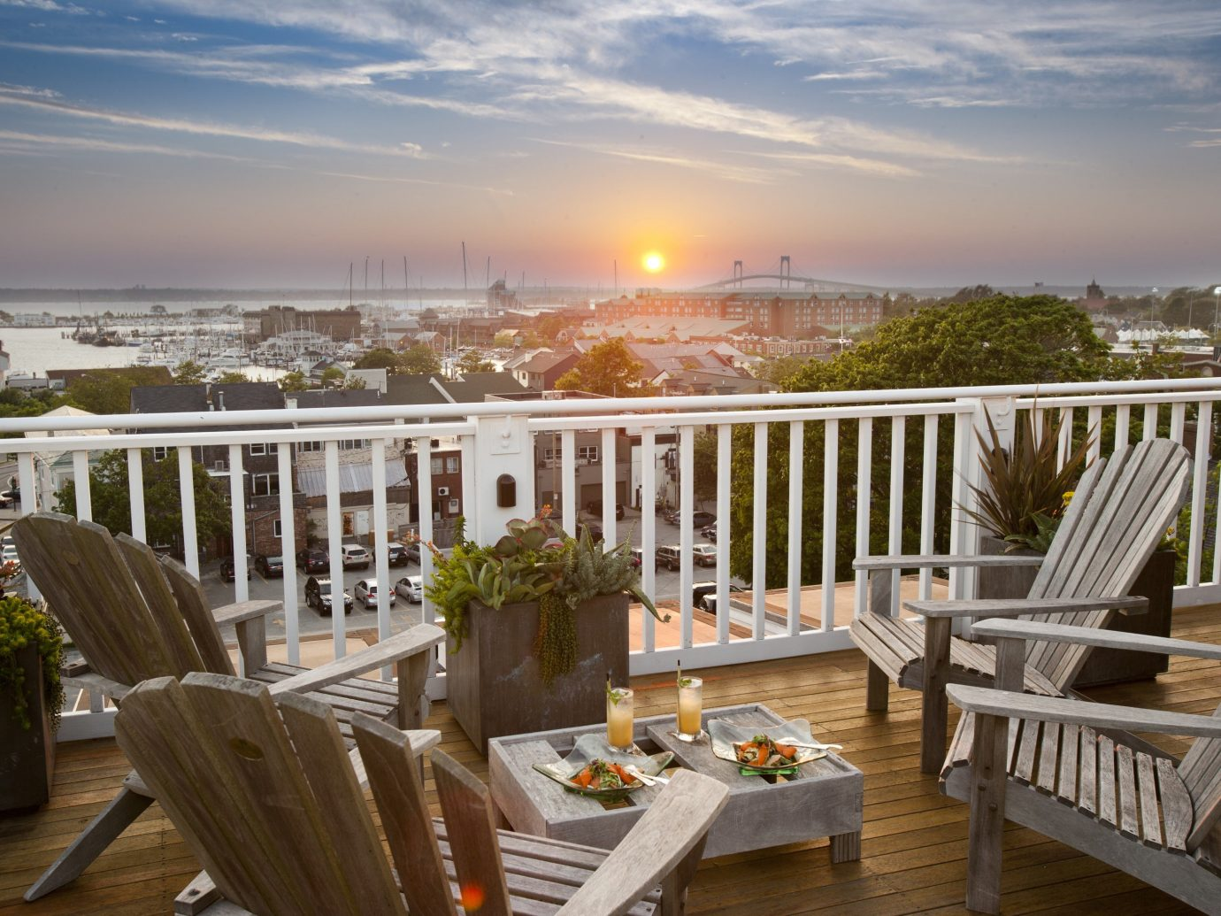 Hotels Trip Ideas sky table outdoor chair property building vacation estate Deck overlooking wooden porch home real estate Resort outdoor structure Dining Villa set dining table