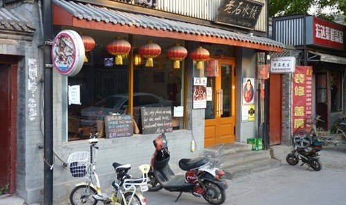 Jetsetter Guides building outdoor street road mode of transport Town sidewalk motorcycle vehicle store facade City scooter