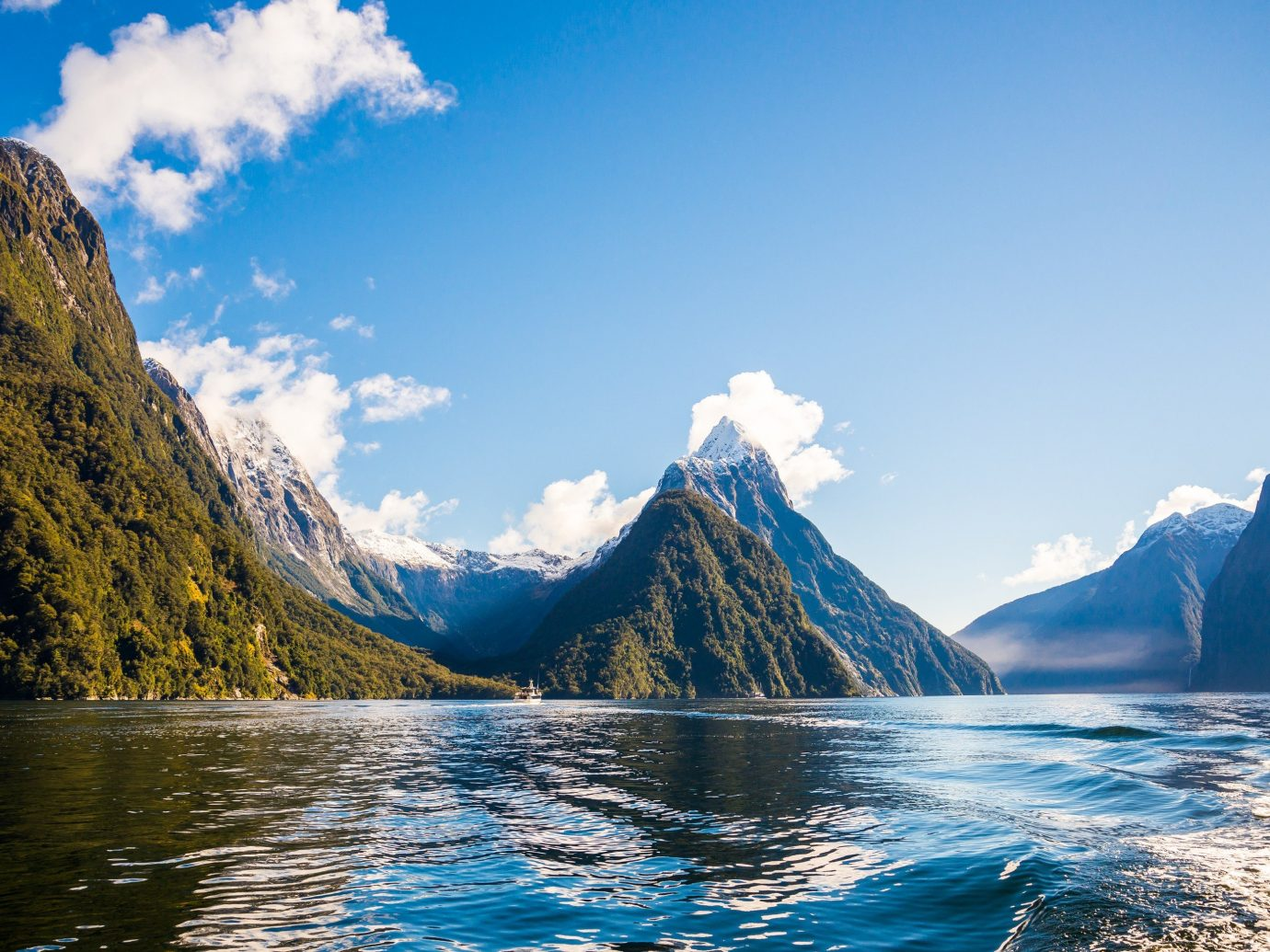 National Parks Trip Ideas mountain outdoor sky water Nature mountainous landforms geographical feature landform fjord Lake mountain range Sea reflection loch glacial landform vehicle surrounded clouds day distance