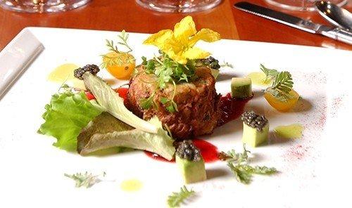 Food + Drink table dish food indoor meat meal hors d oeuvre cuisine garnish restaurant steak tartare several piece de resistance