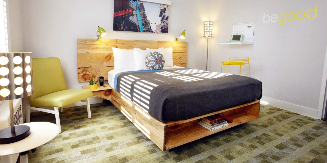 Hotels floor indoor wall room Living property Bedroom furniture bed living room hardwood real estate cottage interior design bed frame Suite bed sheet apartment wood