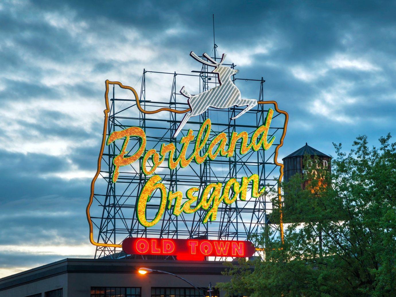 Budget sky outdoor text sign landmark urban area amusement park park tower