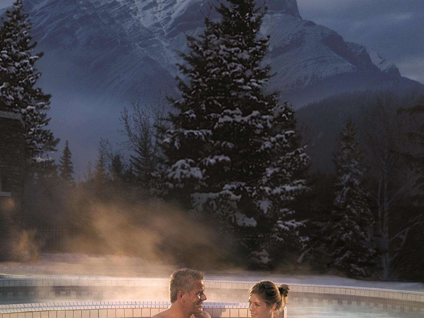 Health + Wellness Hotels Spa Retreats Trip Ideas outdoor sky snow mountainous landforms landform atmospheric phenomenon Winter weather mountain season morning reflection sunlight mountain range water feature