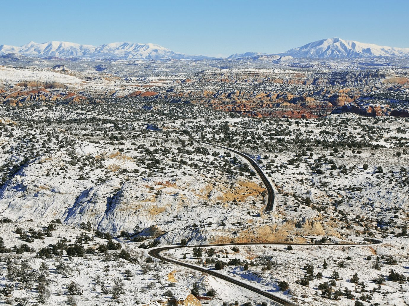 Road Trips Trip Ideas outdoor sky mountain aerial photography snow photography Winter geological phenomenon residential area landscape mountain range Nature geology panorama piste cityscape