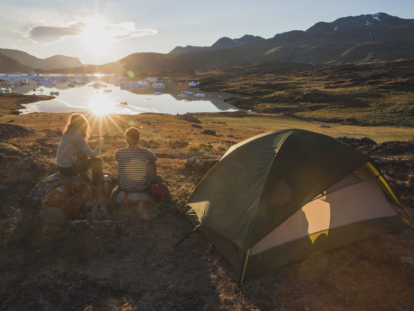Travel Tips sky outdoor mountain ground mountainous landforms atmospheric phenomenon wilderness tent morning rock hill outdoor object landscape Sea Coast sunlight terrain valley sandy