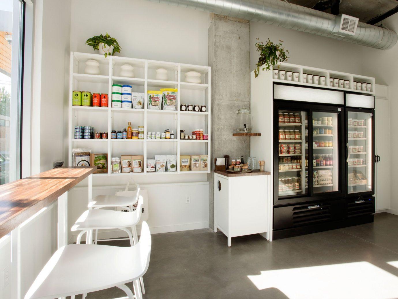 Food + Drink floor indoor property room interior design retail real estate Design cabinetry window covering