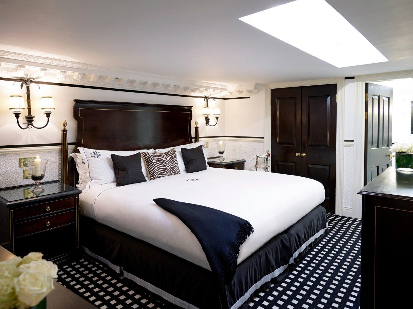 Boutique Hotels Hotels bed indoor wall ceiling room floor Bedroom property Suite hotel interior design estate cottage yacht real estate bed sheet bed frame furniture