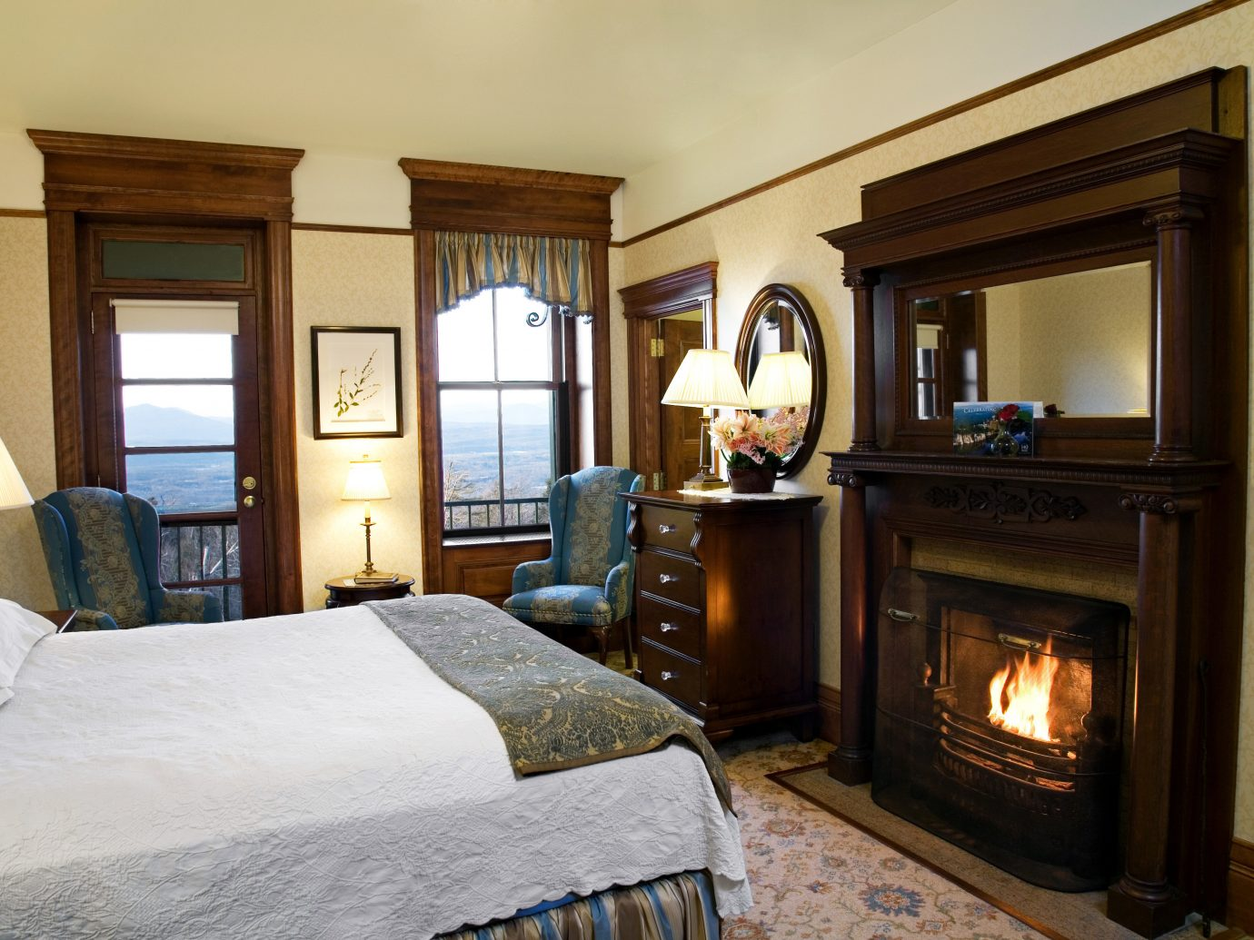 Bedroom Classic Fireplace Hotels Lakes + Rivers Luxury Mountains New York Outdoor Activities Resort Romance Romantic Hotels indoor wall room bed floor property estate home house living room Suite cottage real estate interior design mansion Villa farmhouse apartment decorated