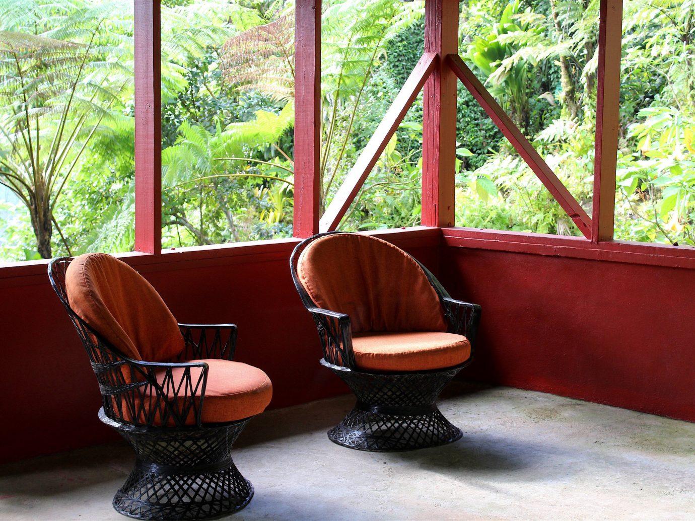 Trip Ideas window indoor tree floor chair room furniture property red home living room table interior design Design seat