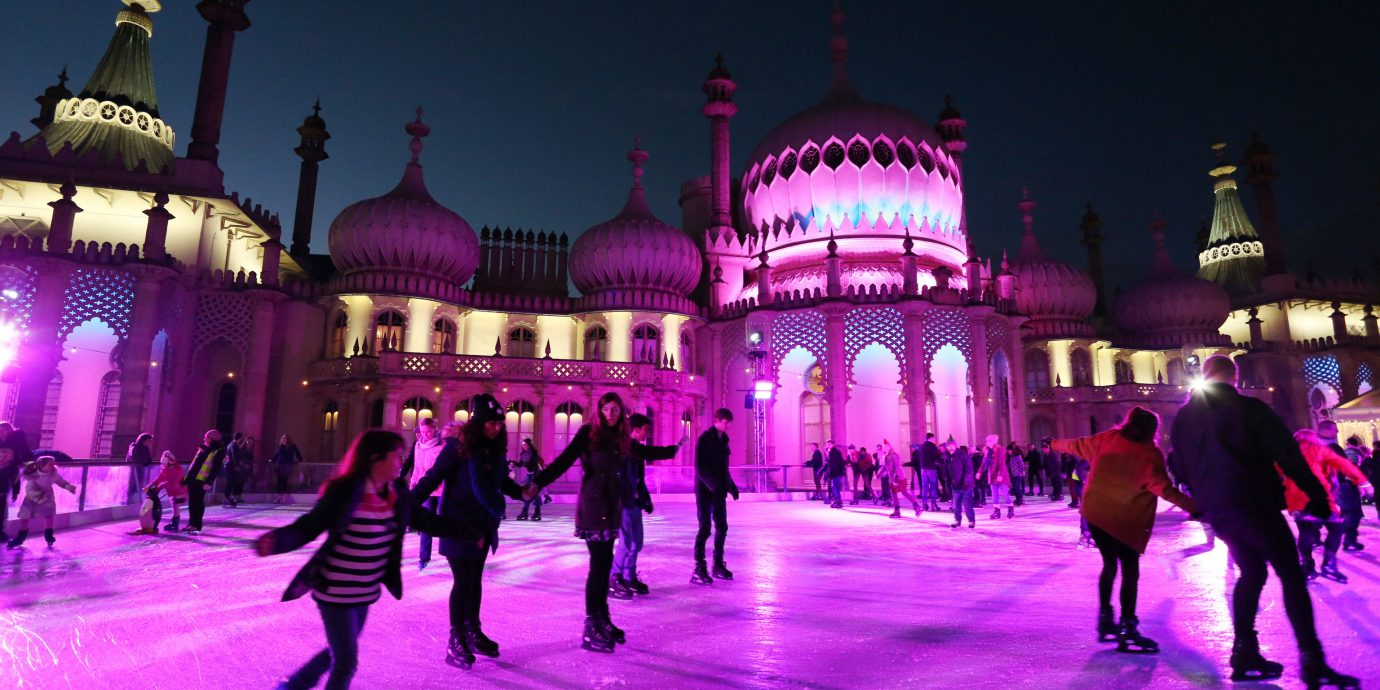 Offbeat building crowd night walking ice rink evening rink Resort amusement park light