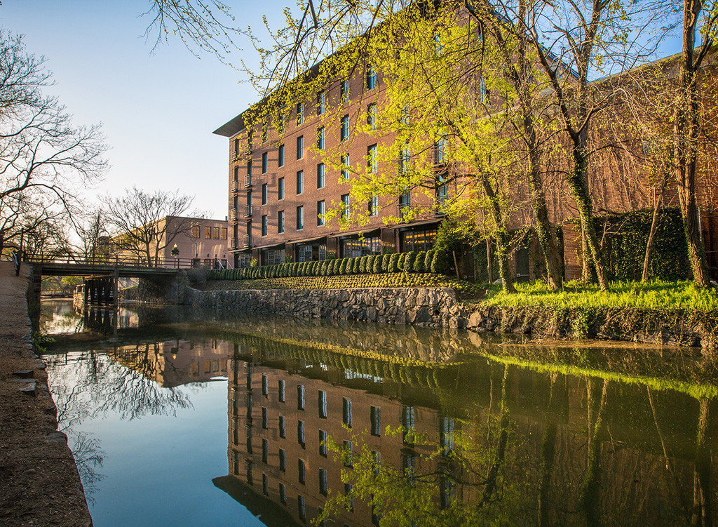 Boutique Hotels Hotels reflection water waterway Nature tree leaf woody plant sky plant Canal moat pond bank estate stately home River grass tourist attraction watercourse building house spring château national trust for places of historic interest or natural beauty landscape autumn evening City Garden facade branch