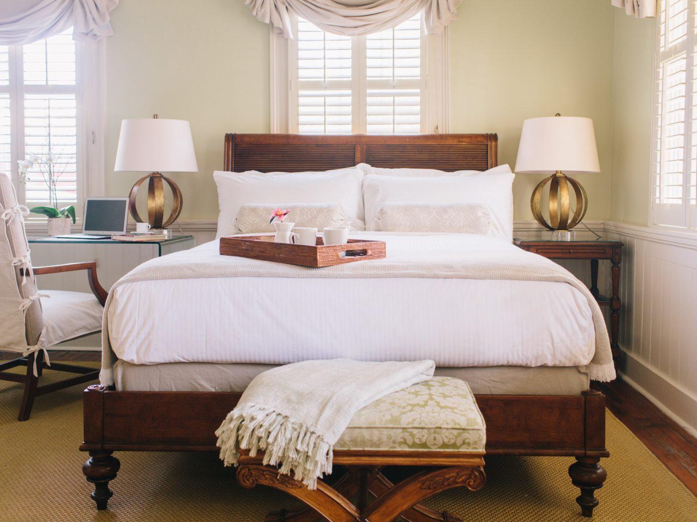 Hotels indoor floor bed room window Bedroom property hotel hardwood home cottage furniture interior design bed frame living room Suite real estate bed sheet estate