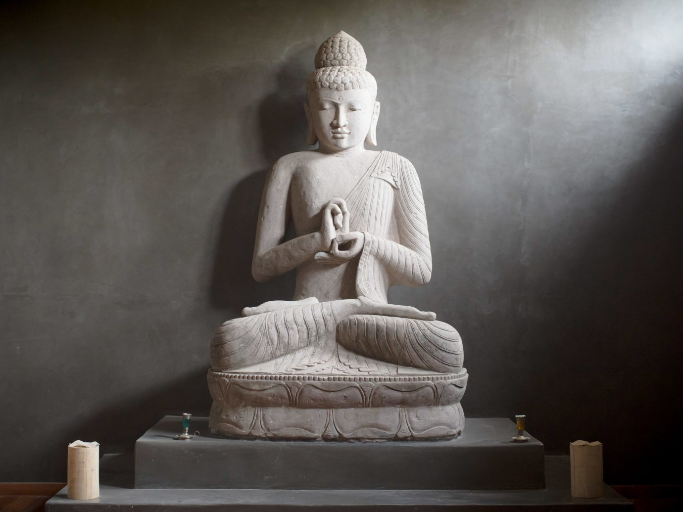 Hotels Solo Travel wall statue indoor sculpture monument human positions gautama buddha art stone carving ancient history temple carving
