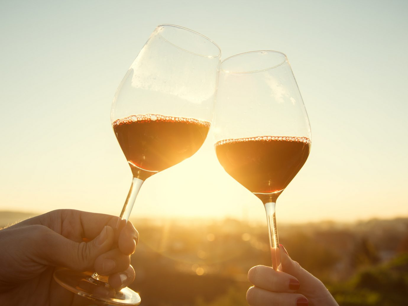 Food + Drink Girls Getaways Travel Tips Trip Ideas Weekend Getaways wine sky person alcoholic beverage Drink wine glass stemware glass alcohol red wine close up morning reflection distilled beverage liqueur sense food container drinkware champagne white wine beverage