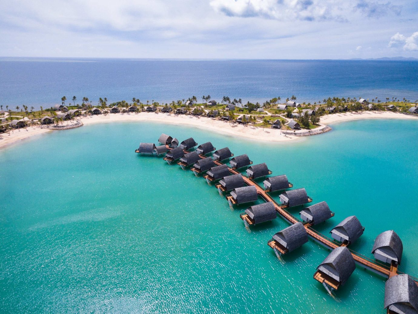 Romantic Getaways sky water outdoor coastal and oceanic landforms Ocean Sea Nature promontory Island tropics Coast Lagoon bay islet tourism caribbean aerial photography vacation atoll swimming pool archipelago inlet cape lined reef shore line