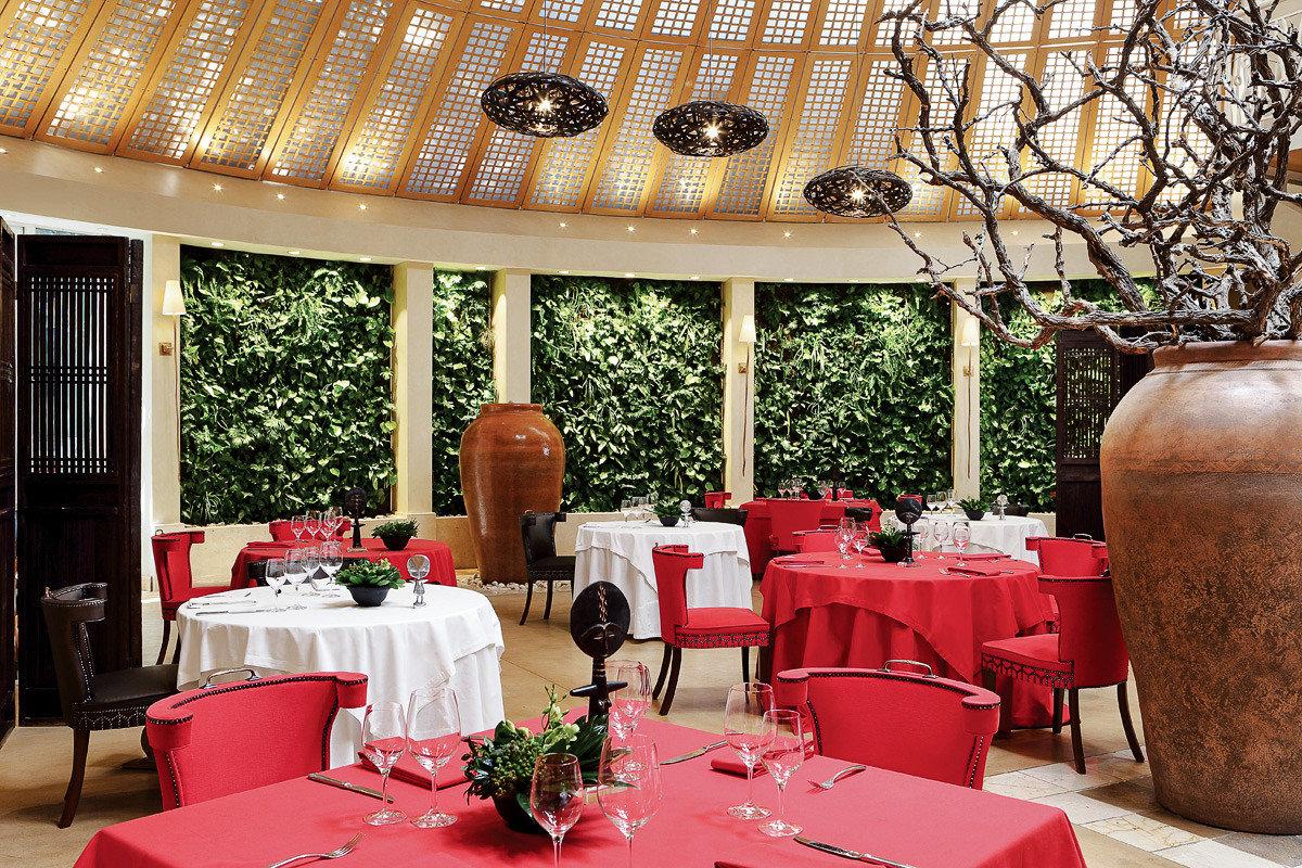 Arts + Culture Trip Ideas table function hall restaurant red interior design centrepiece ceremony banquet wedding reception furniture several arranged