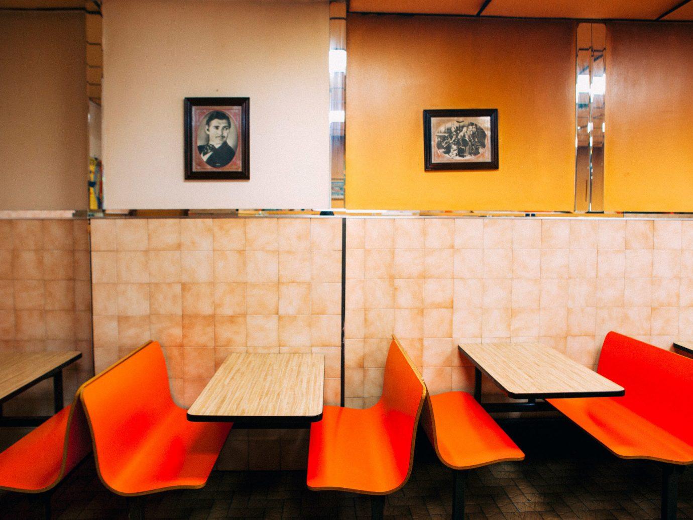 Food + Drink indoor wall floor color red orange room yellow interior design art Design restaurant furniture colored