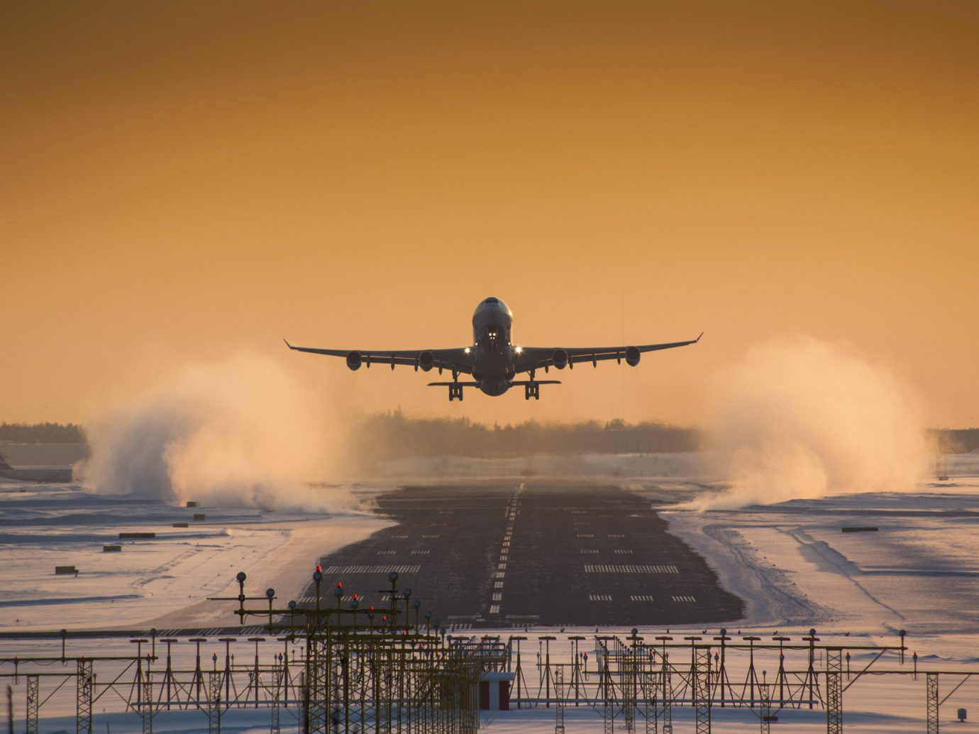 aerial airplane airport flying landing road snow Sunset transportation Travel Tips Winter outdoor sky plane smoke atmospheric phenomenon airline coming aviation aircraft atmosphere of earth airliner vehicle morning flight air force sunrise takeoff wing runway engine
