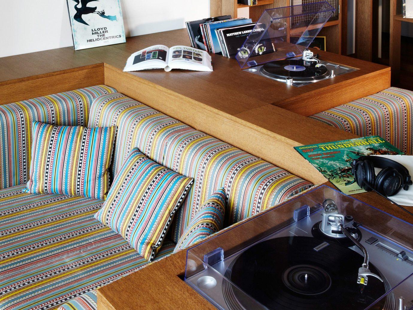 Hotels indoor room countertop floor hardwood home living room flooring interior design wood bed sheet table material cluttered