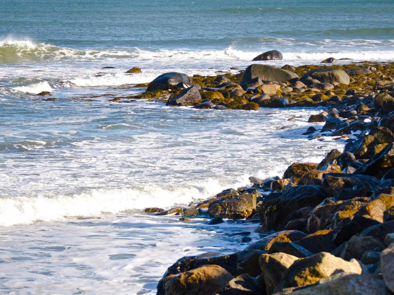 sky water outdoor Coast Sea shore rock Ocean body of water Beach Nature wave wind wave horizon vacation sand cape bay material cove Sunset promontory sandy