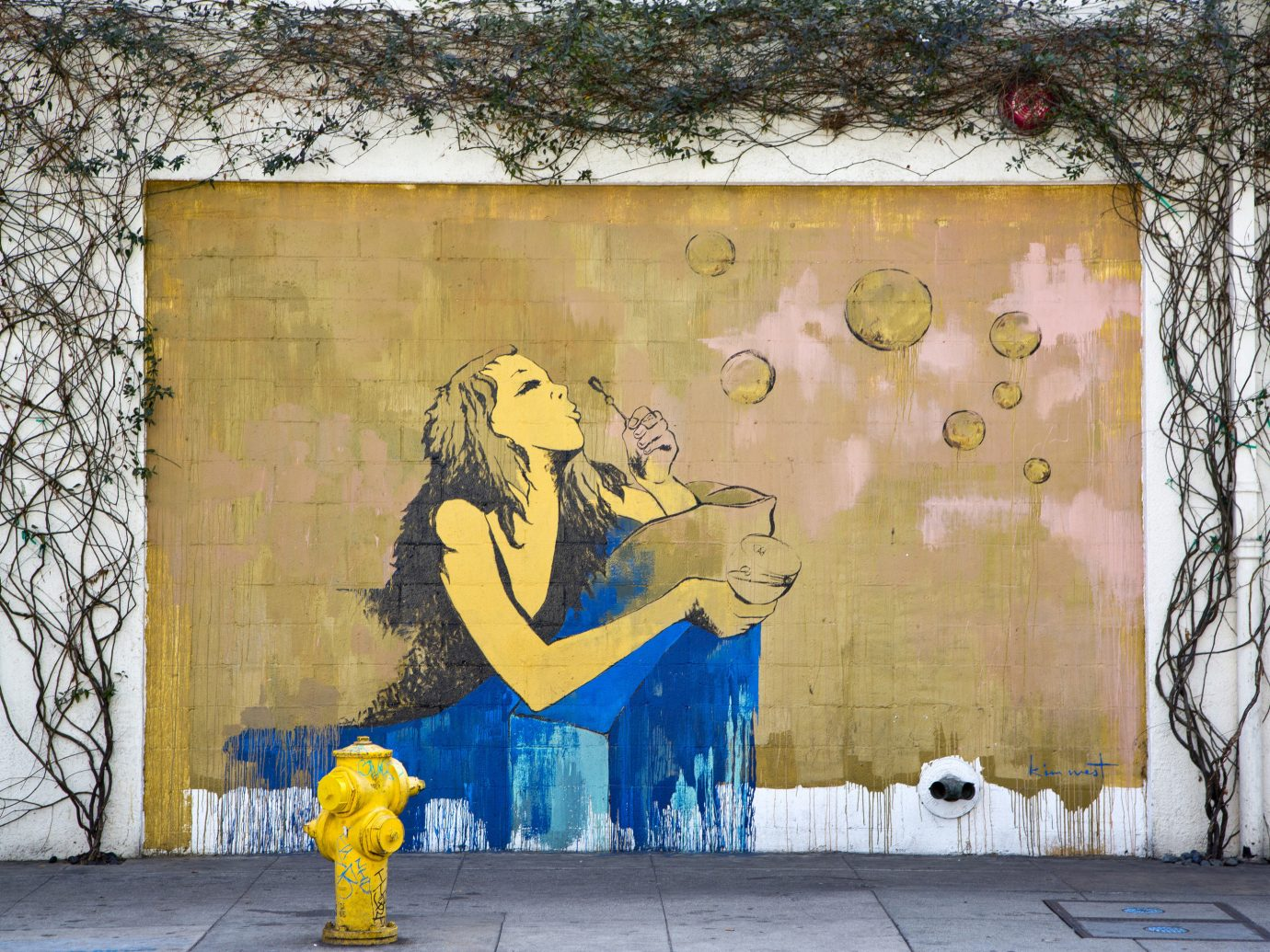Trip Ideas tree outdoor color yellow hydrant mural wall urban area art graffiti street art road street painting painted